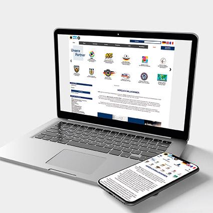 Krüger Website auf einem Laptop und einem Smartphone